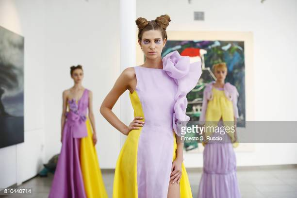 Models pose the runway at the Filippo Laterza Show during Altaroma on July 7 2017 in Rome Italy