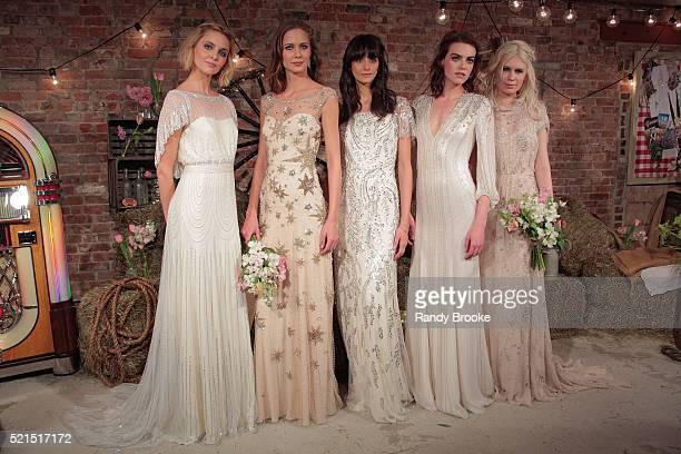 Models pose wearing a look from the Jenny Packham Bridal Spring/Summer 2017 Presentation at Jenny Packham Showroom on April 15 2016 in New York City