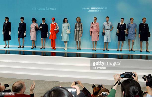 Models pose wearing all Air France uniforms since 1950 during a presentation of the latest version designed by Christian Lacroix in Paris France...