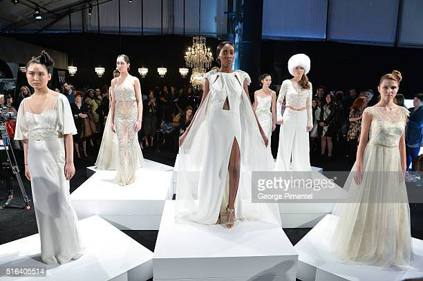 Models pose wearing Di Carlo Couture 2016 collection during Toronto Fashion Week Fall 2016 at David Pecaut Square on March 18 2016 in Toronto Canada