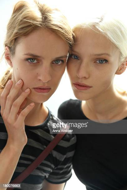 Models pose wearing JINsoon Nail Lacquer during JINsoon For Derek Lam Spring/Summer 2014 at Sean Kelly Gallery on September 8 2013 in New York City