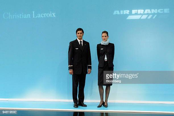 Models pose wearing new Air France uniforms designed by Christian Lacroix at the presentation of the outfits in Paris France Friday April 1 2005