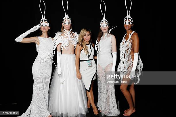 Models pose with a designer of the show backstage ahead of the 3D Fashion Presented By Lexus show during Platform Fashion July 2016 at Areal Boehler...