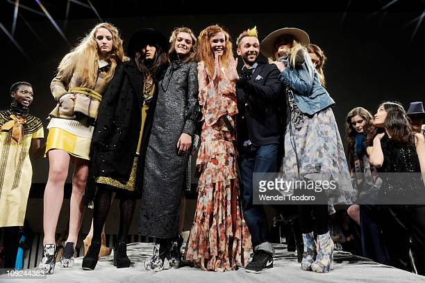 Models pose with designer Chris Benz during the Chris Benz Fall 2011 presentation during MercedesBenz Fashion Week at David Rubenstein Atrium on...