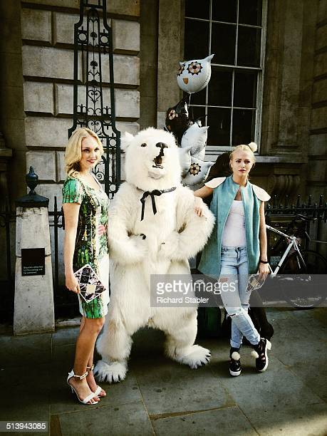 Models pose with Fashion Bear