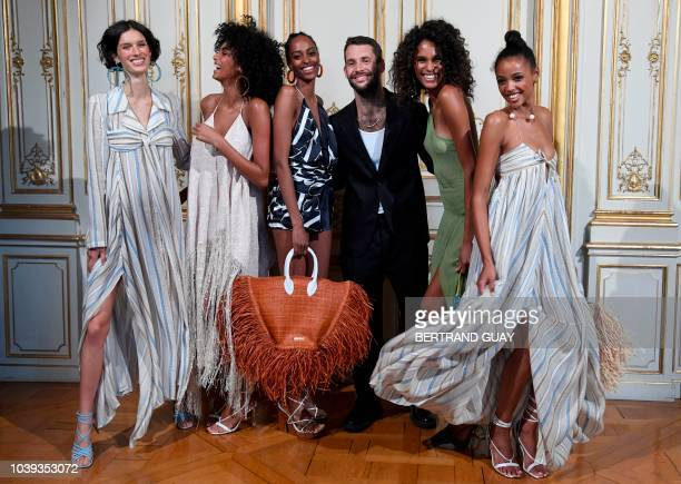 Models pose with French fashion designer Simon Porte Jacquemus during the Jacquemus SpringSummer 2019 ReadytoWear collection fashion show in Paris on...