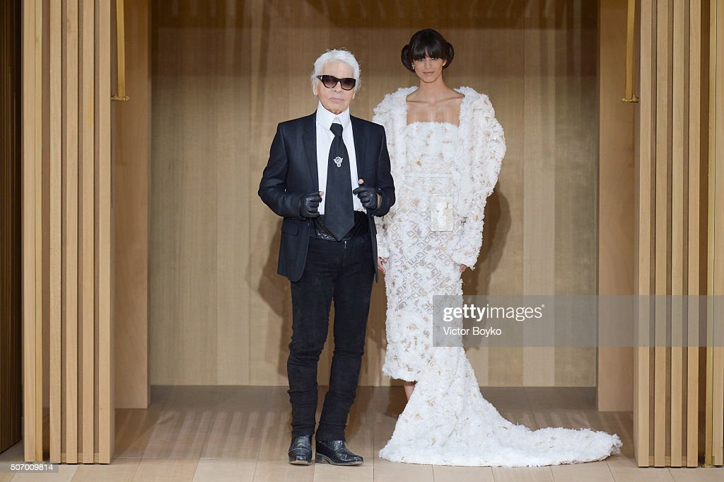 Models pose with Karl Lagerfeld during the finale of the runway at the Chanel Haute Couture Spring Summer 2016 show as part of Paris Fashion Week on January 26, 2016 in Paris, France.