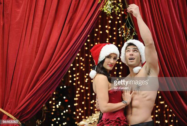 Models pose with mistletoe at the launch of Westfield's Adult Only Grown Up Grotto at Westfield Shopping Centre on December 15 2009 in London England