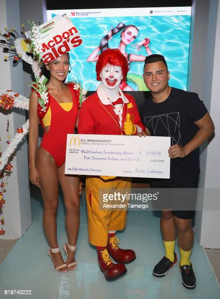 Models pose with Ronald McDonald and Designed by Miami international University of Art and Design Fashion Student Pablo Machado Palomeque winner of...