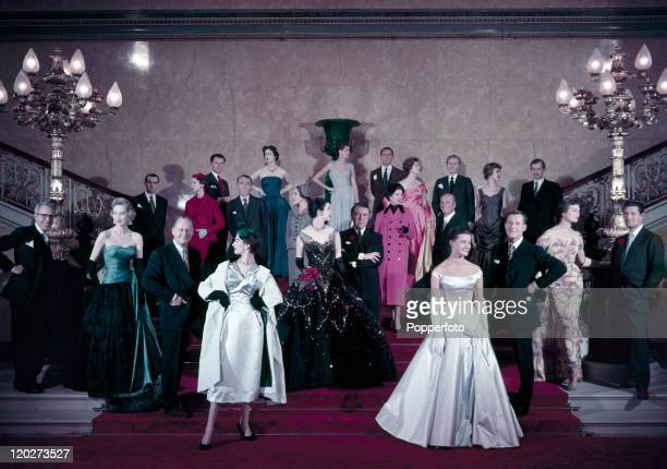 Models pose with the creations of the Society of London Fashion Designers the Big 12 at a fashion show in London on 3rd September 1955