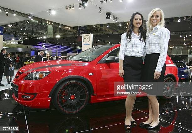 Models pose with the Mazda 3 MPS Extreme at the 2007 Australian International Motor Show at the Sydney Convention and Exhibition Centre on October 11...