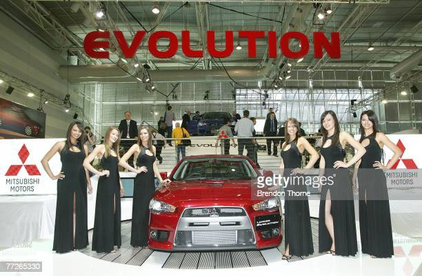 Models pose with the new Mitsubishi Evo X at the 2007 Australian International Motor Show at the Sydney Convention and Exhibition Centre on October...
