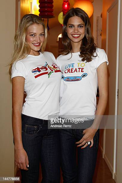 Models poseat the Johnny Pigozzi Limoland Replay Presentation during the 65th Annual Cannes Film Festival on May 19 2012 in Cannes France