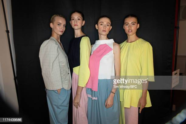 Models poses for a photograph ahead of the Gayeon Lee show during London Fashion Week September 2019 at Foyles on September 13 2019 in London England