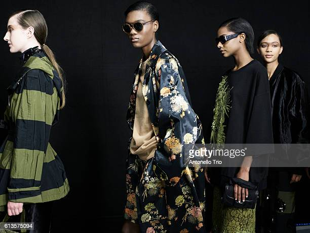 Models poses prior the Dries Van Noten show as part of the Paris Fashion Week Womenswear Spring/Summer 2017 on September 28 2016 in Paris France