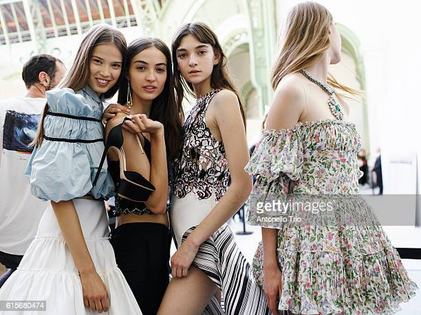 Models poses prior the Giambattista Valli show as part of the Paris Fashion Week Womenswear Spring/Summer 2017 on October 3 2016 in Paris France