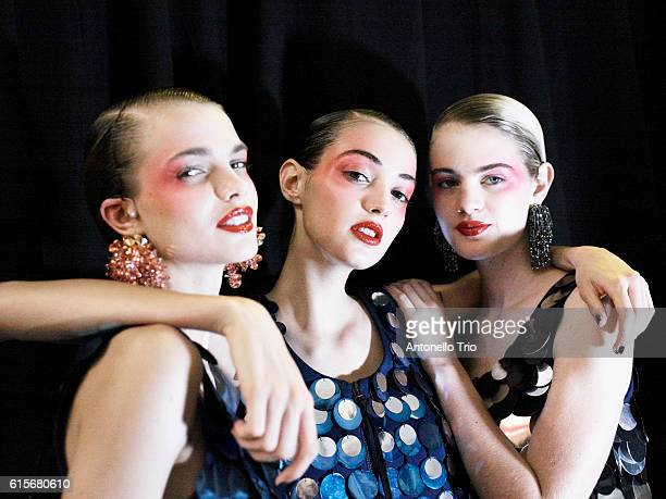 Models poses prior the Kenzo show as part of the Paris Fashion Week Womenswear Spring/Summer 2017 on October 4 2016 in Paris France