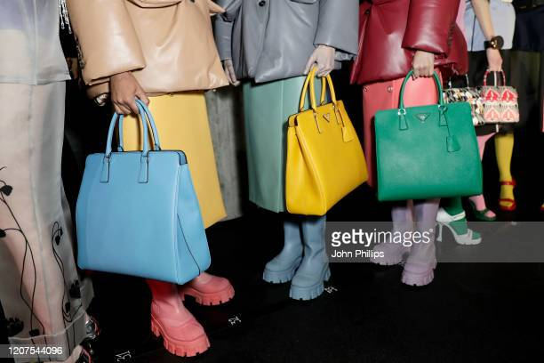 Models posing, bag detail, backstage at the Prada fashion show on February 20, 2020 in Milan, Italy.
