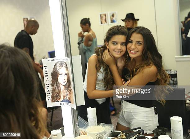 Models prepare at hair and makeup backstage before the Binzario Couture fashion show and designer collective during September 2016 New York Fashion...