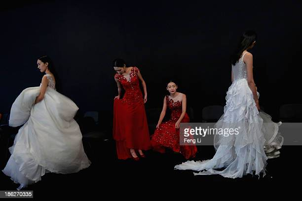 Models prepare backstage ahead of Peng Jing Wedding Dress Collection show during MercedesBenz China Fashion Week Spring/Summer 2014 at 751 DPARK...
