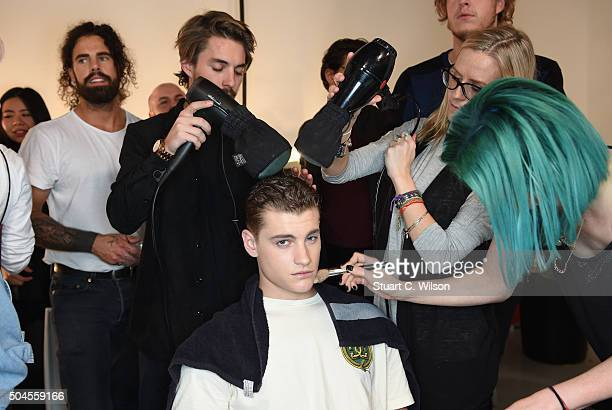 Models prepare backstage ahead of the Bobby Abley show during The London Collections Men AW16 at Victoria House on January 11 2016 in London England