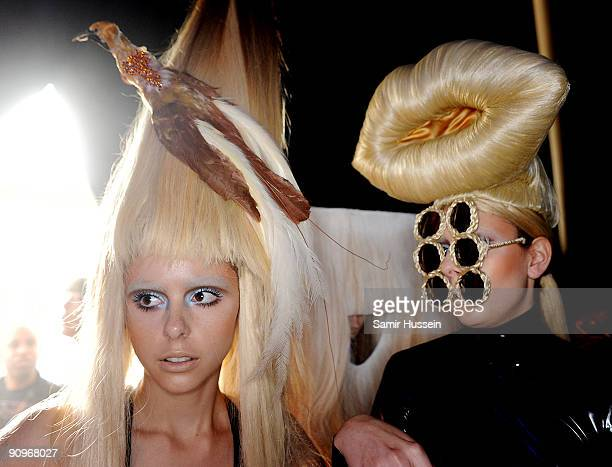 Models prepare backstage ahead of the Charlie Le Mindu Spring/Summer 2010 show as part of Blow Presents during London Fashion Week at the Royal...