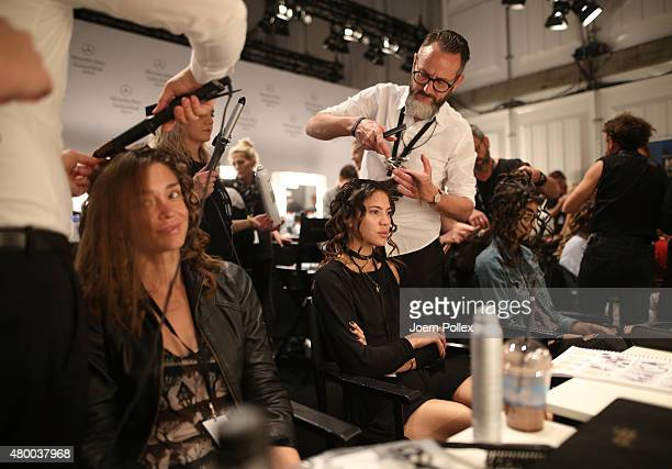 Models prepare backstage ahead of the Dimitri show during the Mercedes-Benz Fashion Week Berlin Spring/Summer 2016 at Brandenburg Gate on July 9,...