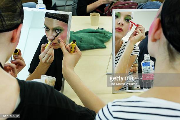 Models prepare backstage ahead of the DRESSCAMP show as part of Mercedes Benz Fashion Week TOKYO 2015 S/S at Shibuya Hikarie on October 13 2014 in...