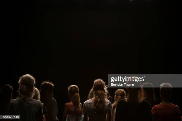 Models prepare backstage ahead of the Duvenage show at MercedesBenz Fashion Week Australia 2014 at Carriageworks on April 9 2014 in Sydney Australia