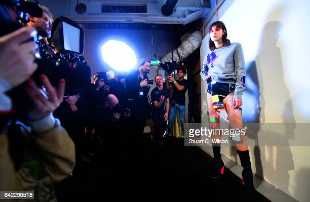 Models prepare backstage ahead of the FYODOR GOLAN show during the London Fashion Week February 2017 collections on February 17 2017 in London England