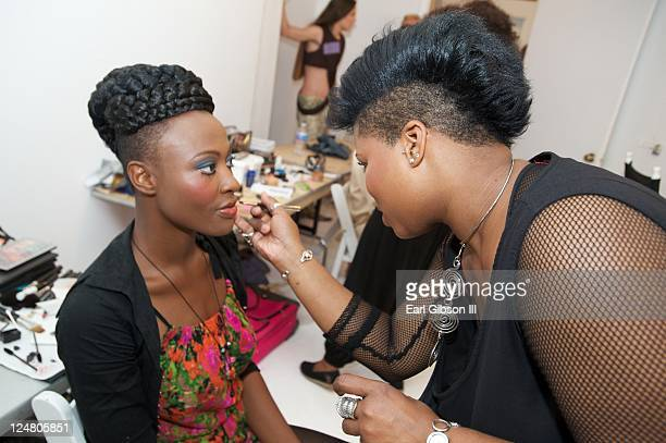 Models prepare backstage ahead of the Saint Wobil - Darius Wobil Spring 2012 fashion show during Mercedes-Benz Fashion Week at Studio 450 on...
