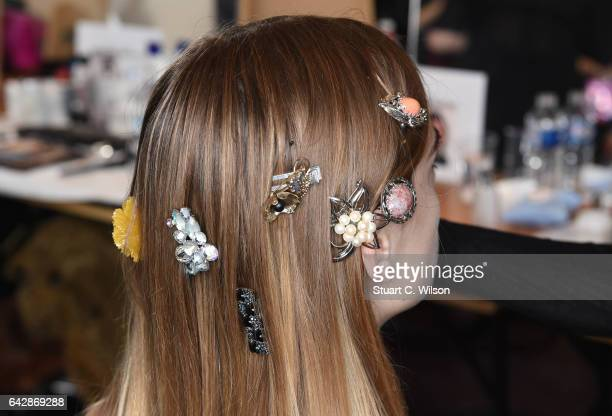 Models prepare backstage ahead of the TOGA show during London Fashion Week February 2017 collections on February 19 2017 in London England