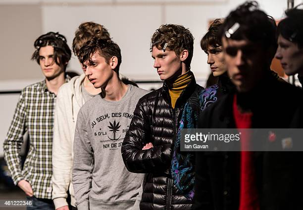 Models prepare backstage ahead of the TOPMAN Design show at the London Collections Men AW15 at The Old Sorting Office on January 9 2015 in London...