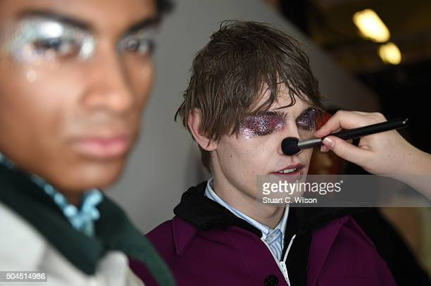 Models prepare backstage ahead of the Xander Zhou show during The London Collections Men AW16 at Victoria House on January 11 2016 in London England