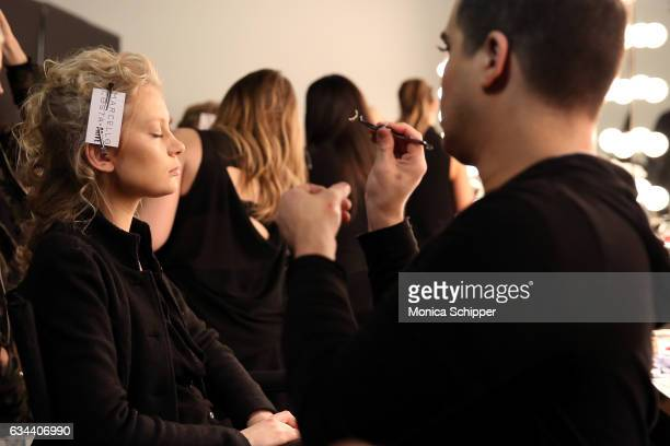 Models prepare backstage at the Ane Amour fashion show during New York Fashion Week at Pier 59 on February 9 2017 in New York City