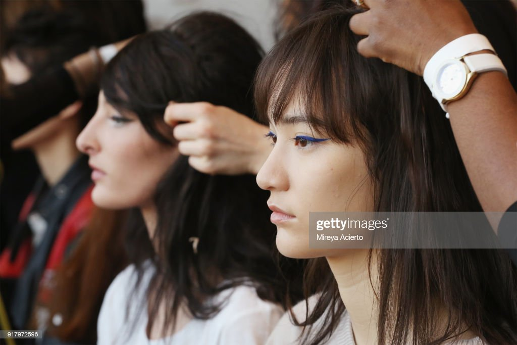 Models prepare backstage at the Calvin Luo fashion show during New York Fashion Week on February 13, 2018 in New York City.