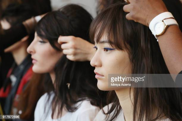 Models prepare backstage at the Calvin Luo fashion show during New York Fashion Week on February 13 2018 in New York City