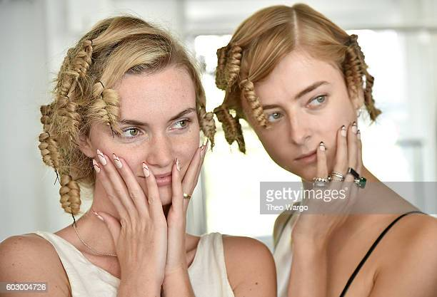 Models prepare backstage at the Carmen Marc Valvo Spring/Summer 2017 Fashion Show during New York Fashion Week at Pier 59 Studios on September 11...