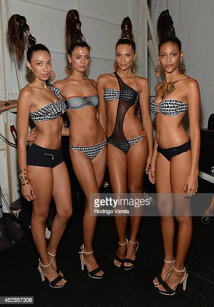 Models prepare backstage at the Dolores Cortes show during MercedesBenz Fashion Week Swim 2015 at Cabana Grande at The Raleigh on July 18 2014 in...