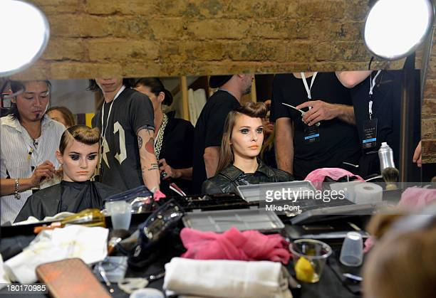 Models prepare backstage at the Hache presentation during MercedesBenz Fashion Week Spring 2014 at Hosfelt Gallery on September 9 2013 in New York...