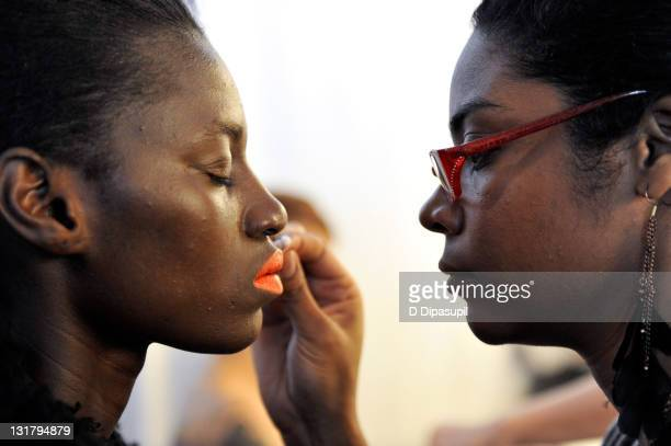 Models prepare backstage at the Lake Stars Fall 2011 presentation during MercedesBenz Fashion Week at Pier 59 Studios on February 11 2011 in New York...