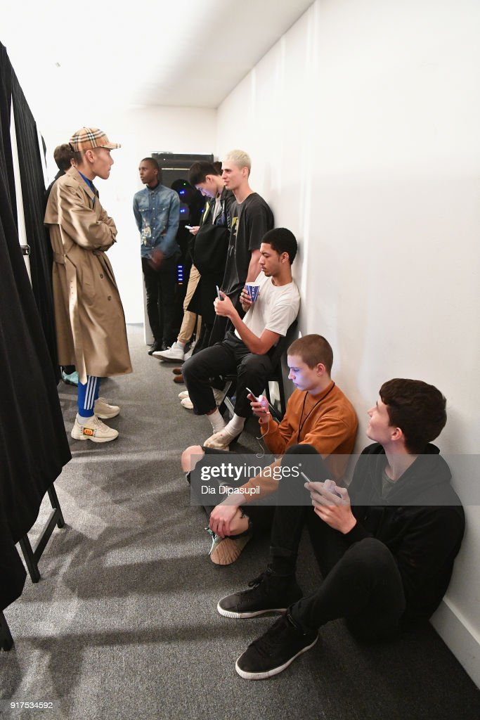 Models prepare backstage at the Libertine fashion show during New York Week: The Shows at Gallery II at Spring Studios on February 12, 2018 in New York City.
