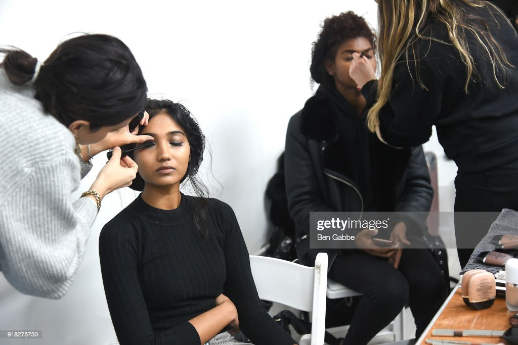 Models prepare backstage at the Maki Oh fashion show during New York Fashion Week on February 14, 2018 in New York City.