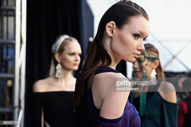 Models prepare backstage at the Mongol fashion show during Mercedes-Benz Fashion Week Fall 2015 at The Theatre at Lincoln Center on February 13, 2015...