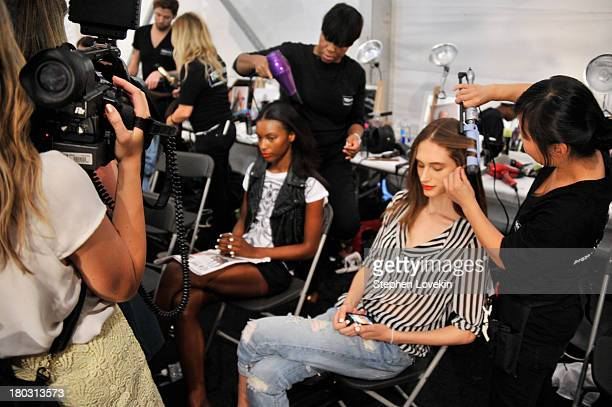 Models prepare backstage at the Nanette Lepore fashion show during MercedesBenz Fashion Week Spring 2014 at The Stage at Lincoln Center on September...