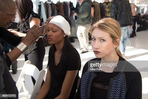 Models prepare backstage at the Nina Athanasiou fashion show during Mercedes Benz Fashion Week Fall 2015 at The Designer's Loft on February 13 2015...