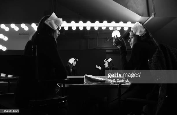 Models prepare backstage at the Pamella Roland fashion show during New York Fashion Week at Pier 59 Studios on February 10 2017 in New York City