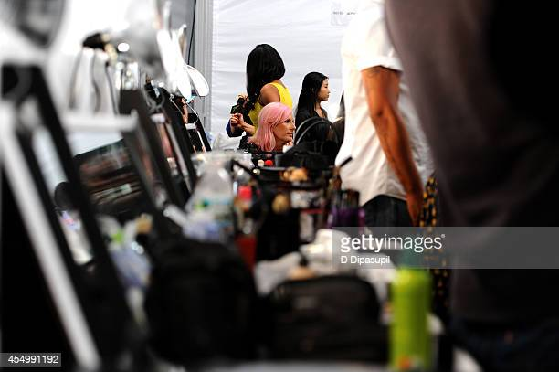 Models prepare backstage at the Reem Acra fashion show during MercedesBenz Fashion Week Spring 2015 at The Salon at Lincoln Center on September 8...