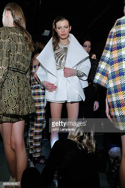 Models prepare backstage at the Sass Bide Show during MercedesBenz Fashion Week Fall 2014 at Classic Car Club on February 12 2014 in New York City