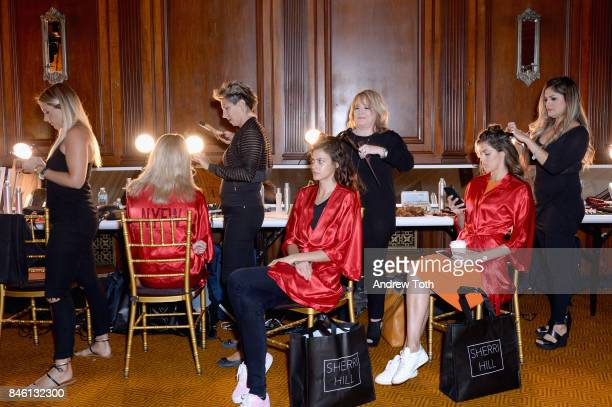 Models prepare backstage at the Sherri Hill NYFW SS18 fashion show at Gotham Hall on September 12 2017 in New York City